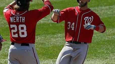Washington Nationals center fielder Bryce Harper is congratulated