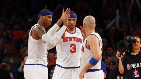 Carmelo Anthony, Kenyon Martin and Jason Kidd celebrate