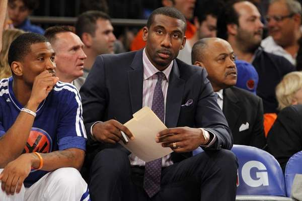 Amar'e Stoudemire looks on from the bench during