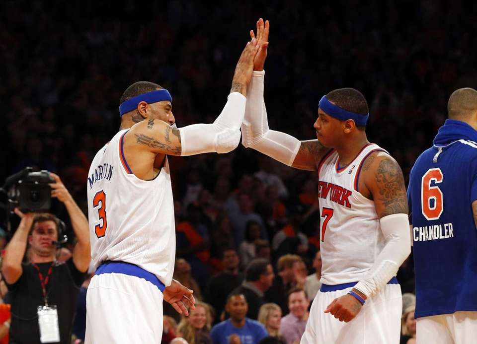 Carmelo Anthony and Kenyon Martin celebrate after a