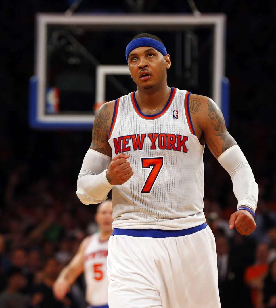 Carmelo Anthony pumps his fist after assisting on