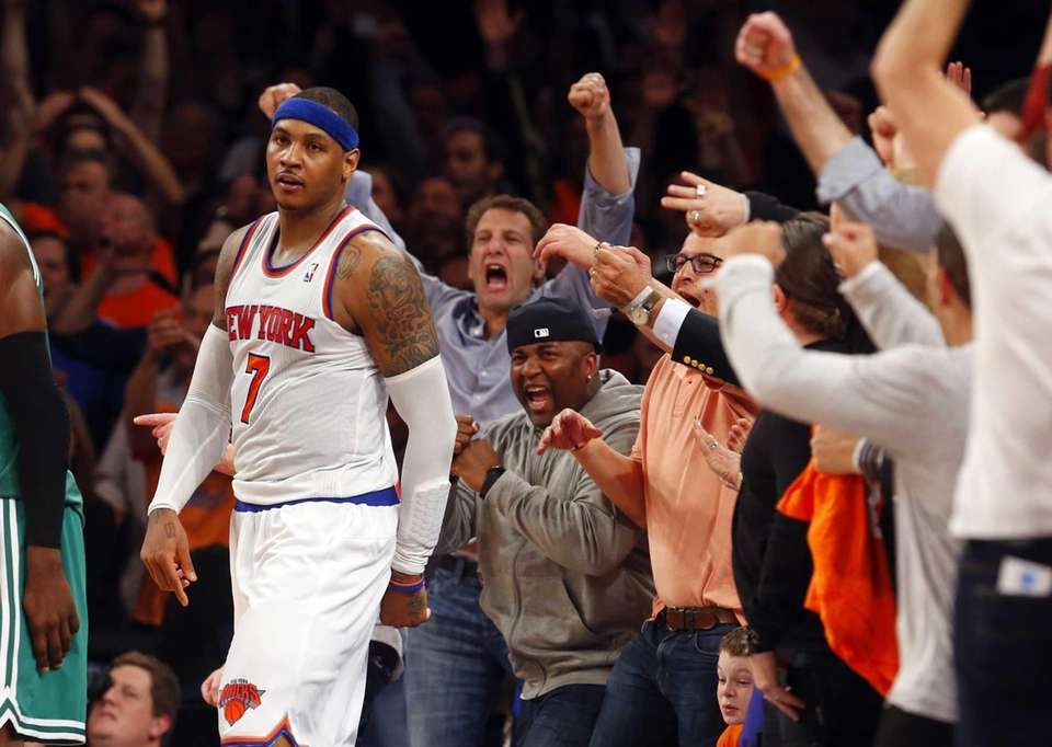 Fans celebrate after Carmelo Anthony hits a fourth-quarter