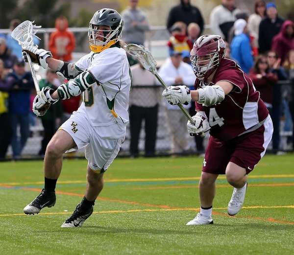 Ward Melville's Brendan Dooley moves behind the net