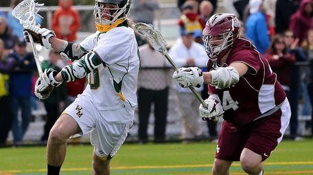 Ward Melville's Brendan Dooley moves behind the net