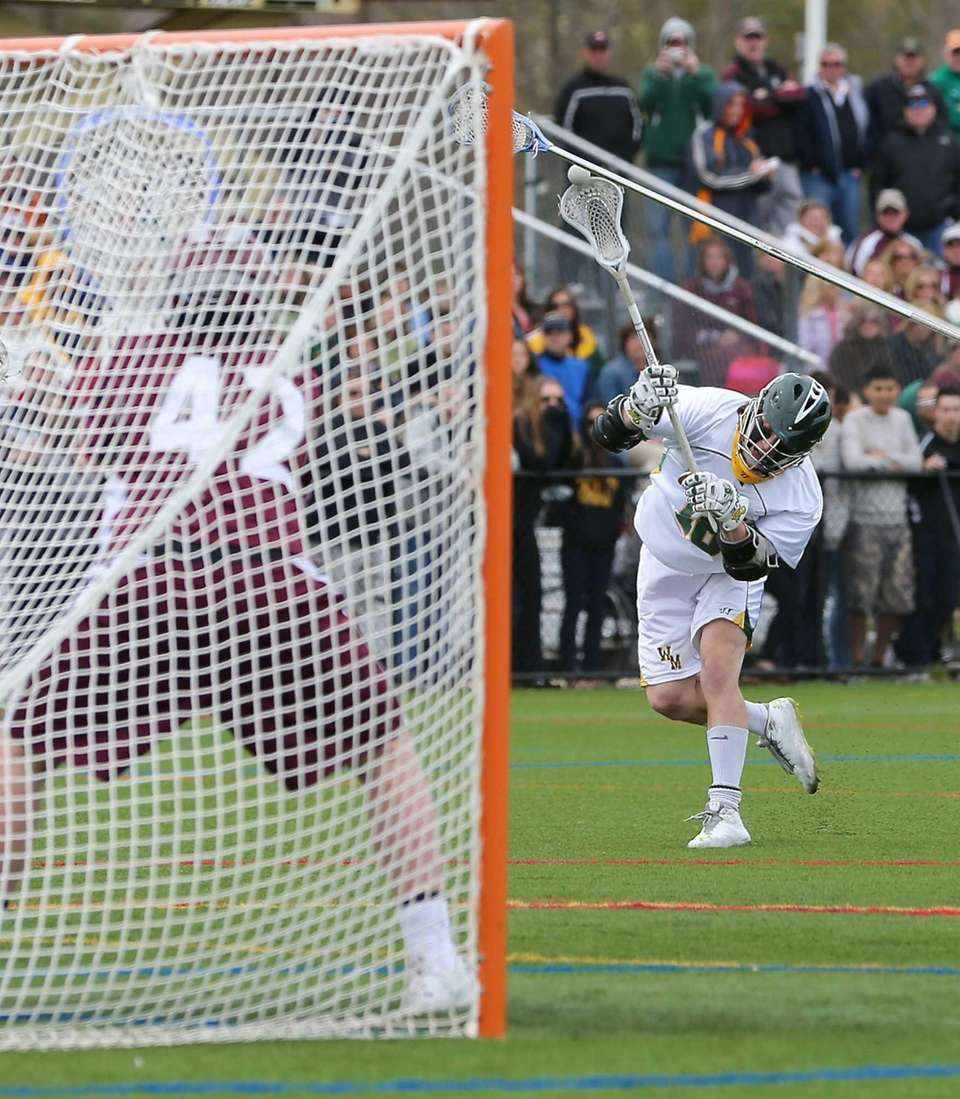 Ward Melville's Jack Bruckner takes the shot on