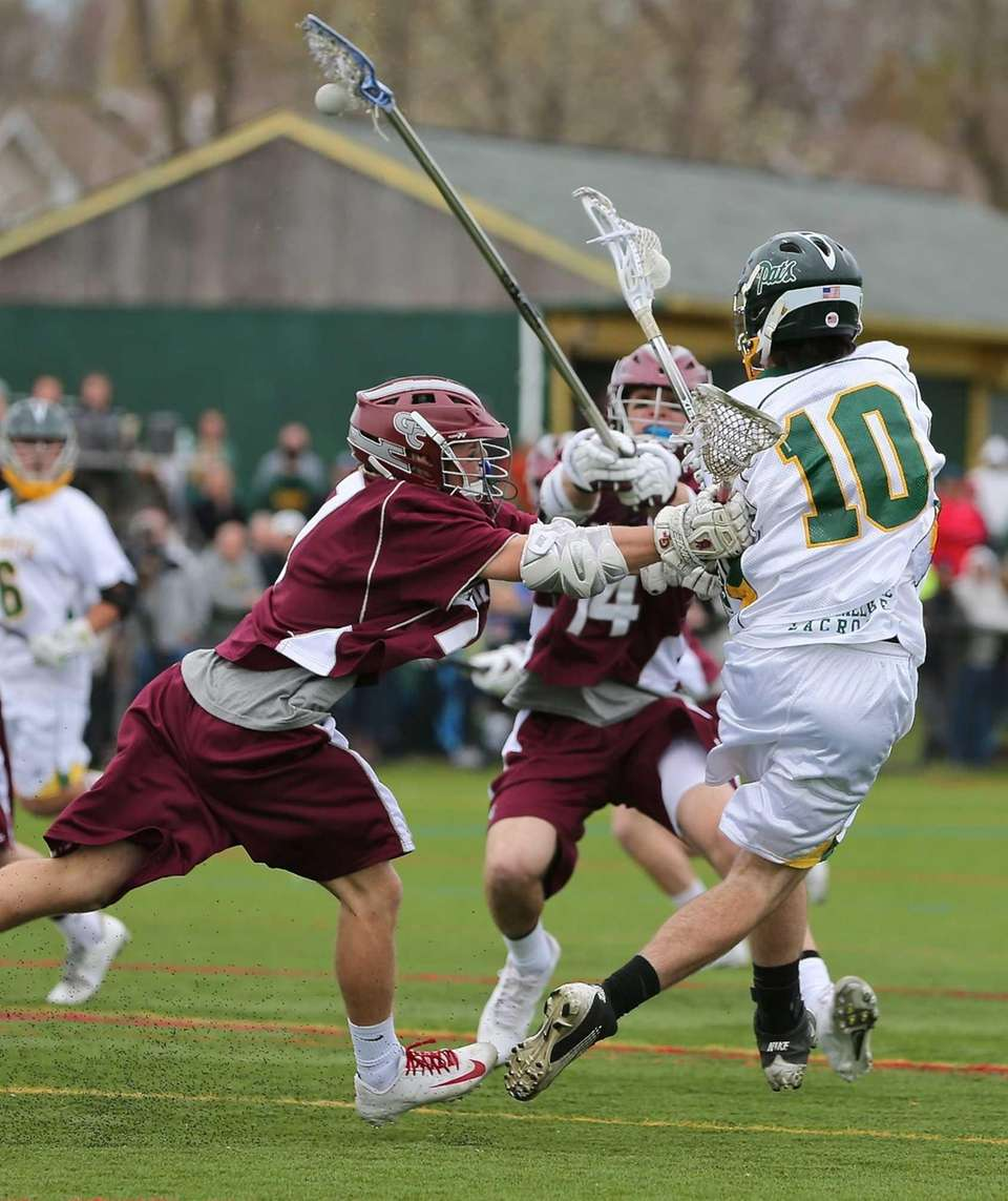 Ward Melville's Brendan Dooley gets the shot off