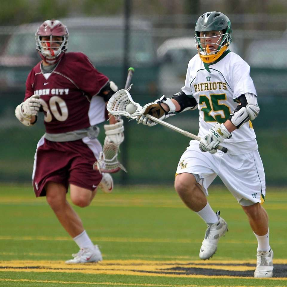 Ward Melville's Adam lapitino moves through midfield as