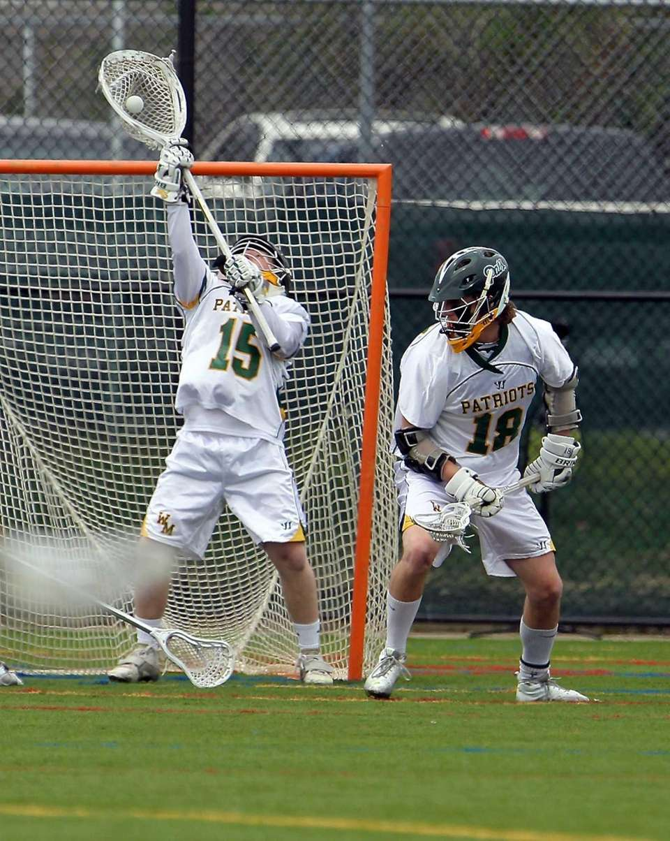 Ward Melville goalie Dan Nemirov makes the stick