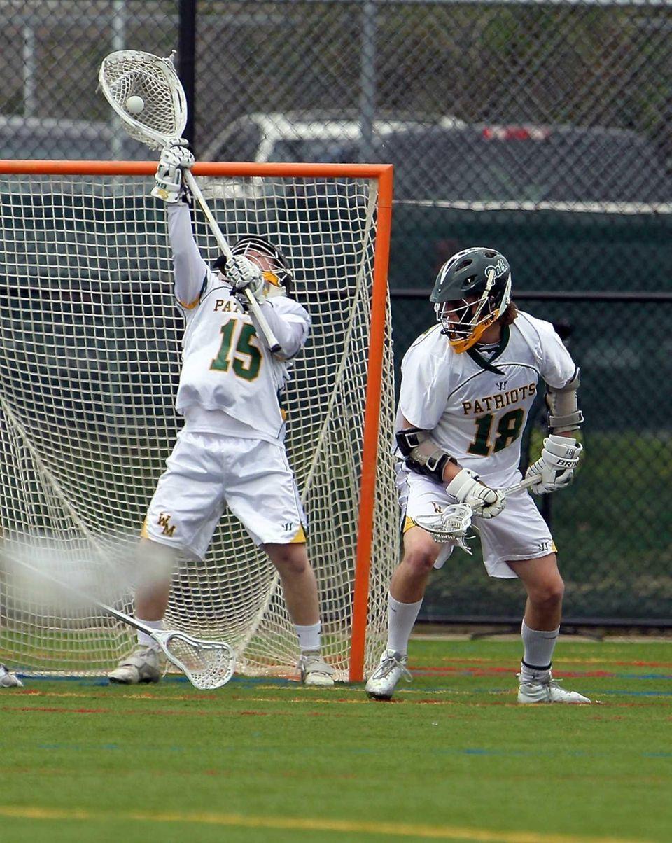 Ward Melville goalie Dan Nemirov makes the stick