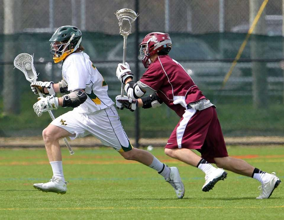 Ward Melville's Jack Bruckner moves past Garden City's