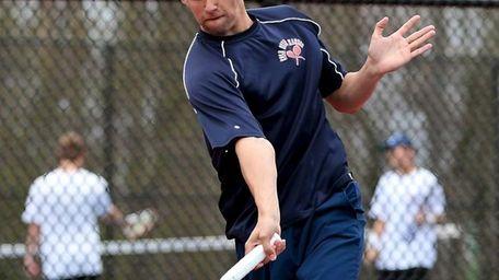 Cold Spring Harbor's Conor Dauer returns the serve