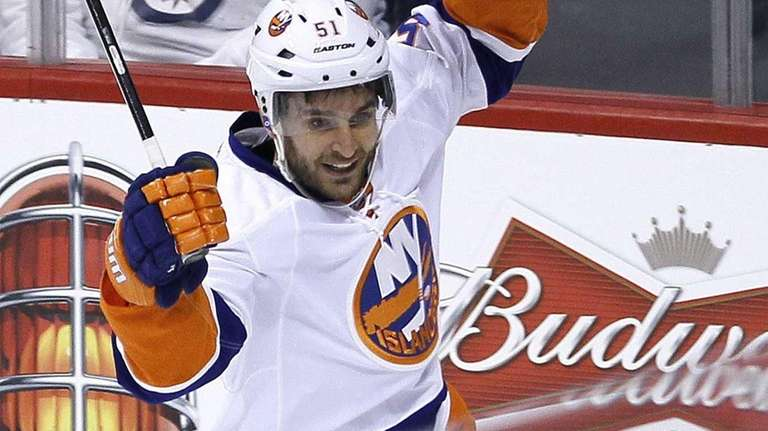 Islanders' Frans Nielsen celebrates his goal against Winnipeg