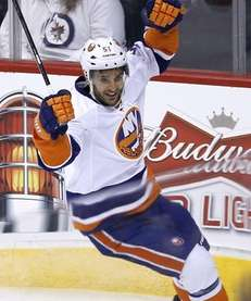Islanders' Frans Nielsen celebrates his goal against Winnipeg