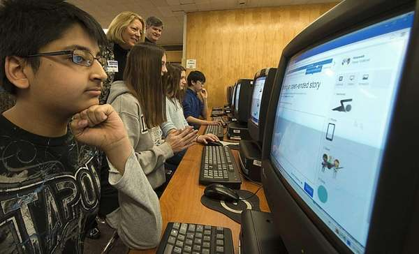 Eighth-grade students at Herricks Middle School use computers