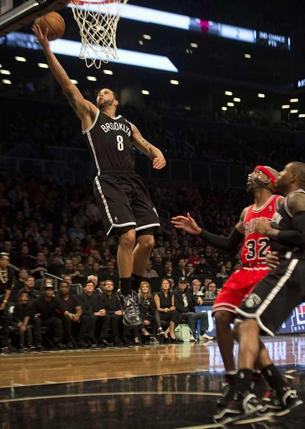 Nets' Deron Williams lays up the ball after