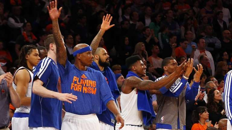 The Knicks bench celebrates late against the Boston