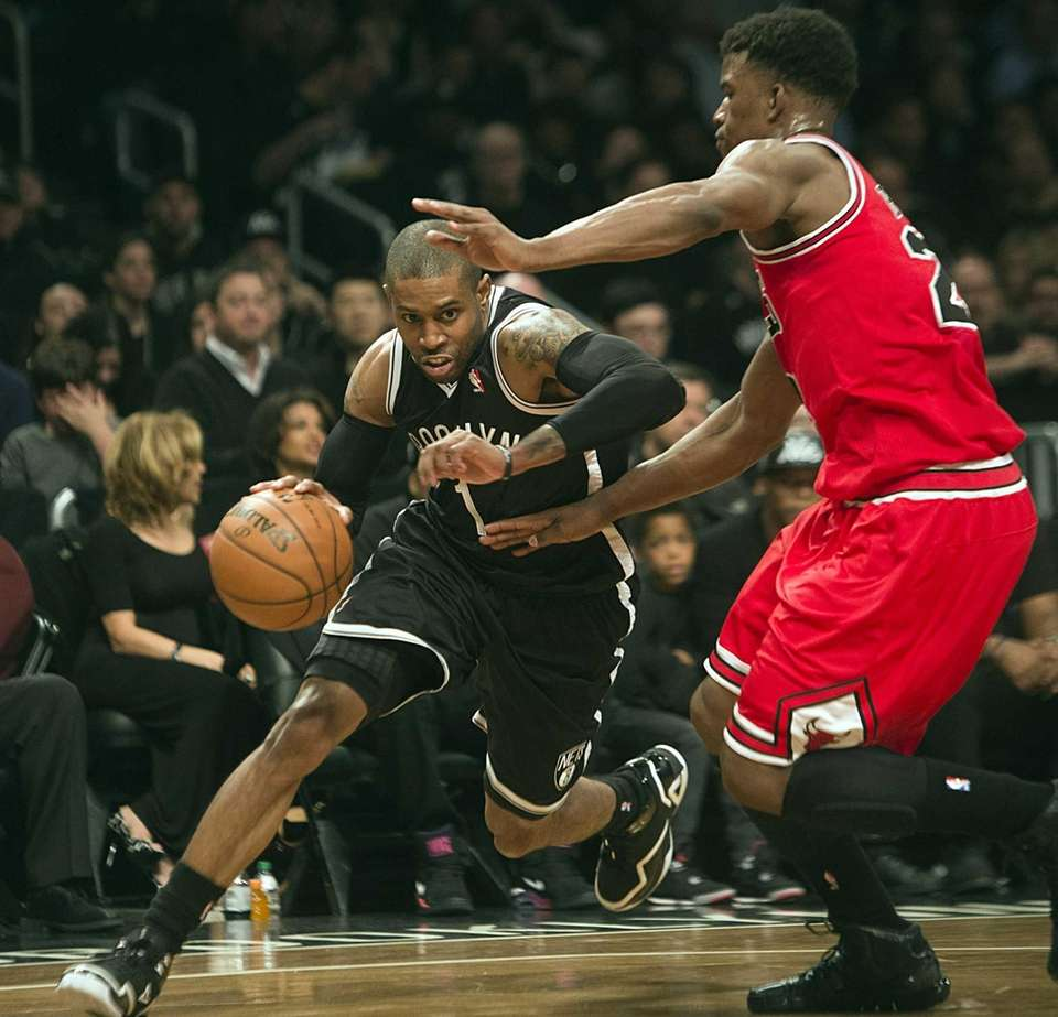 Nets' CJ Watson drives the baseline against the