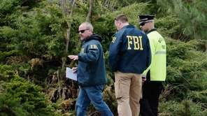 FBI investigators and a Watertown police officer investigate