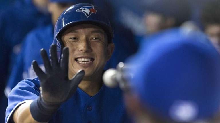The Toronto Blue Jays' Munenori Kawasaki celebrates in