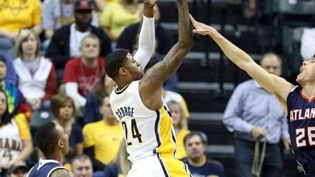 Indiana Pacers forward Paul George shoots the ball