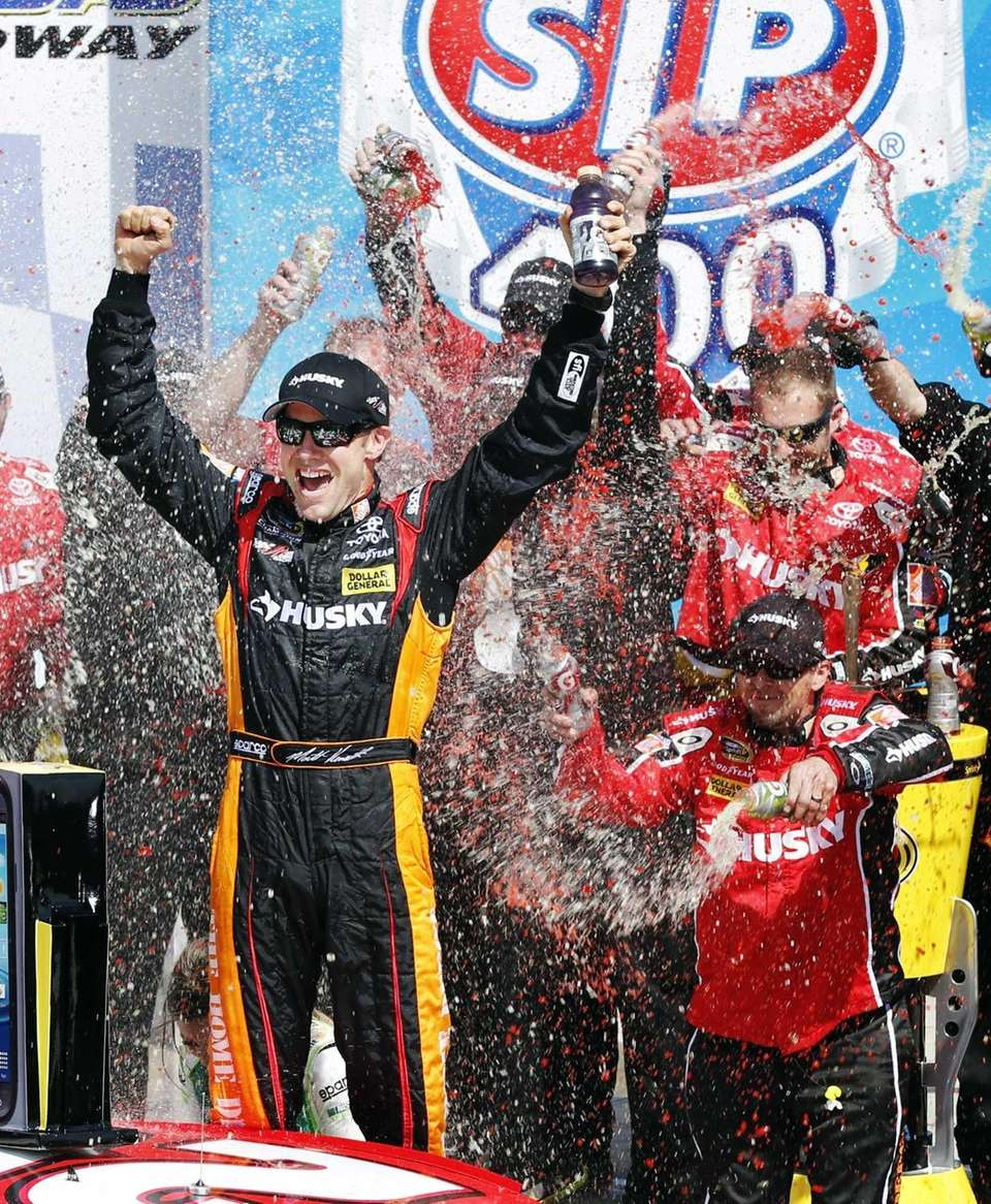 Matt Kenseth (20) celebrates in Victory Lane after