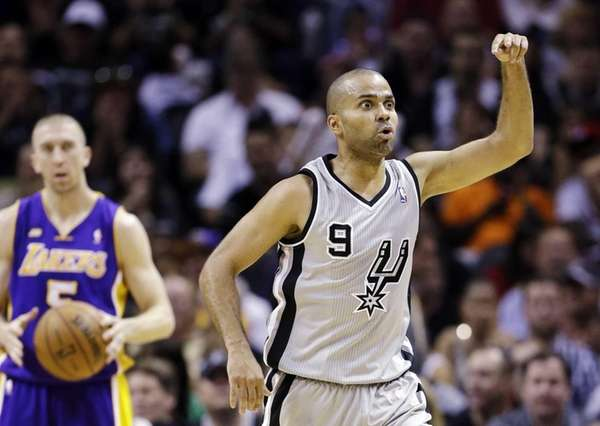 San Antonio Spurs guard Tony Parker asks an
