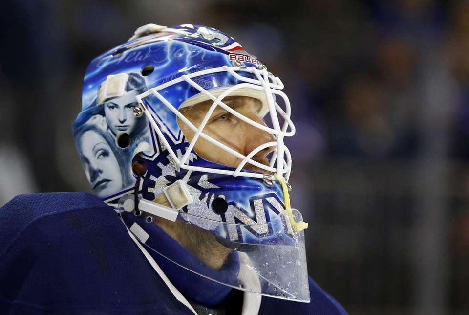 Henrik Lundqvist looks on during a game against