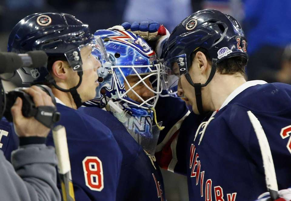 Henrik Lundqvist celebrates with teammates Chris Kreider and