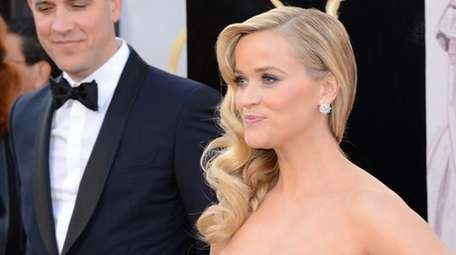 Reese Witherspoon and husband Jim Toth. (Getty Images)