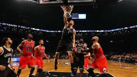 Brook Lopez #11 of the Brooklyn Nets dunks