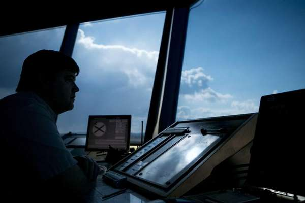 An air traffic controller specialist works at the