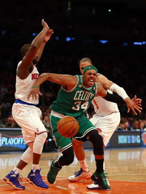 Boston Celtics guard Paul Pierce tries to get
