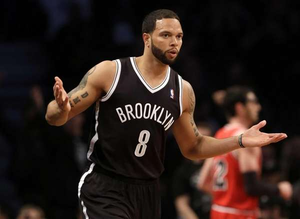 Deron Williams reacts after scoring during Game 1
