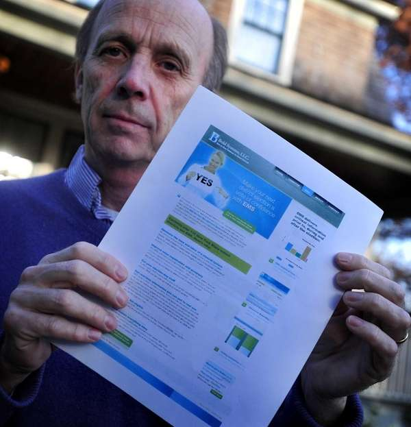 Noel Feustel holds a printout of the website