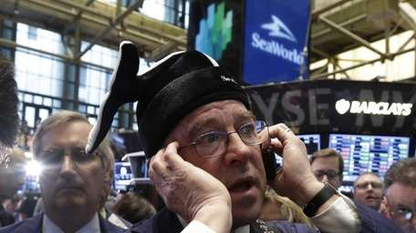 Trader Frederick Reimer wears a whale cap from