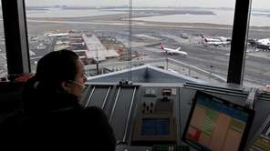 An air traffic controller works in the tower