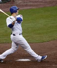 Chicago Cubs' Anthony Rizzo watches his two-run homer