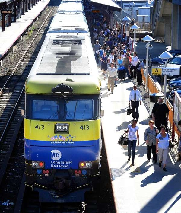 Commuters get off a Long Island Railroad train