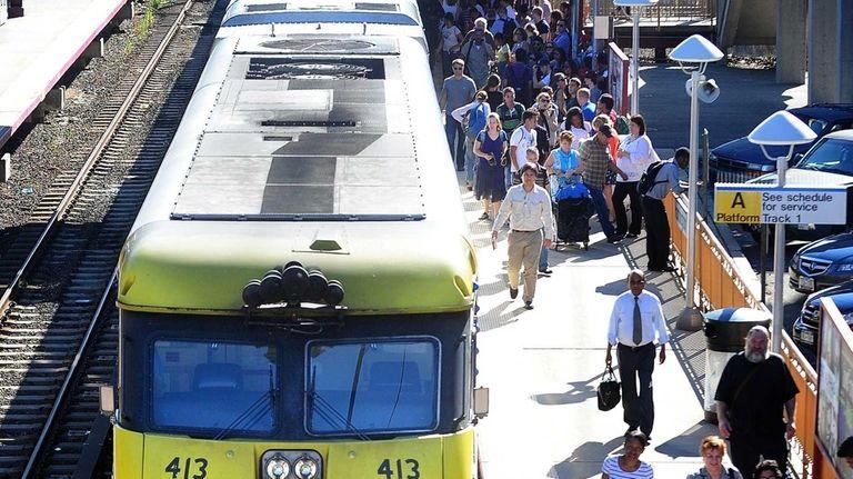 Commuters get off a Long Island Railroad train