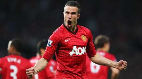 Robin van Persie of Manchester United celebrates after