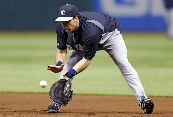 Injured Yankees first baseman Mark Teixeira fields a
