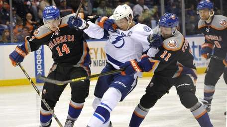 Thomas Hickey (14) and Lubomir Visnovsky (11) fight