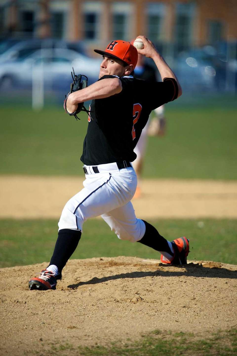 Hicksville pitcher Anthony Salomone (2) delivers a pitch