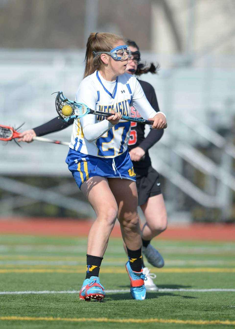 West Islip's Emily Piciullo (27) shoots on goal