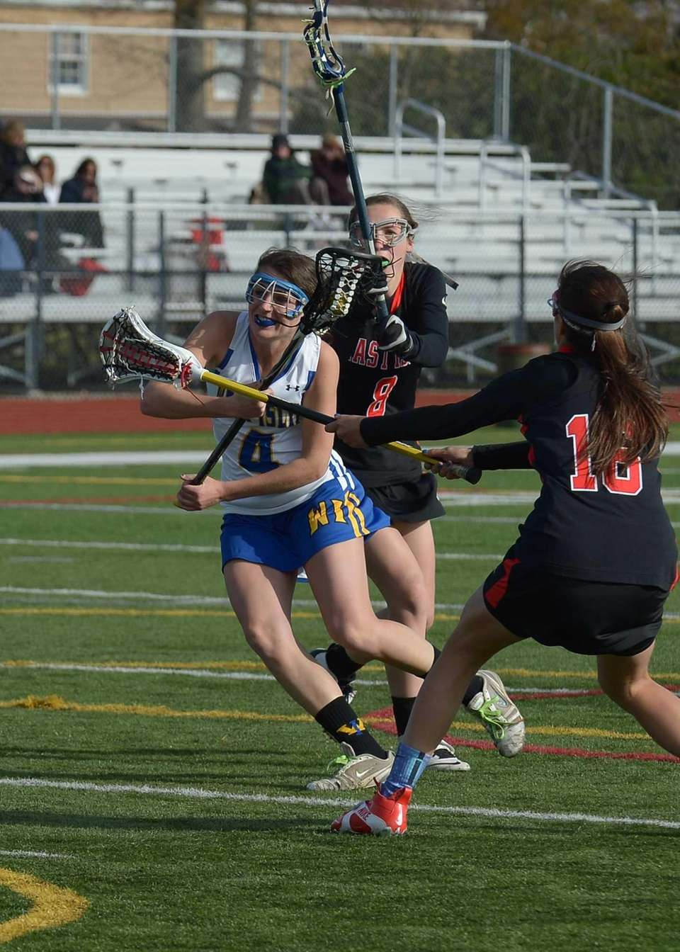 West Islip's Kate Beier (4) races towards the