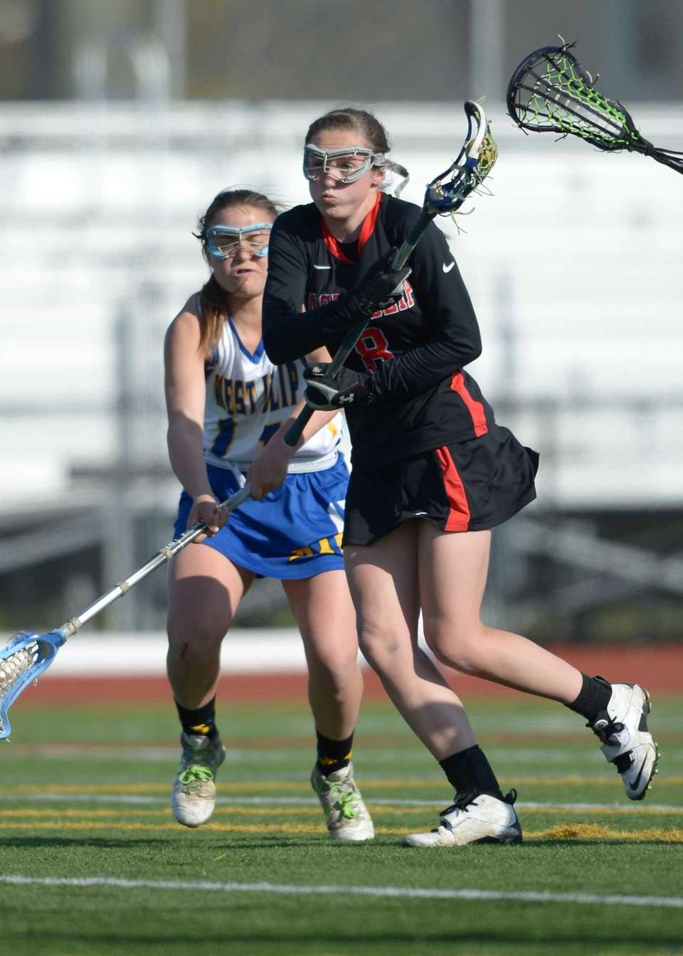 East Islip's Valerie Pelling (8) moves toward the