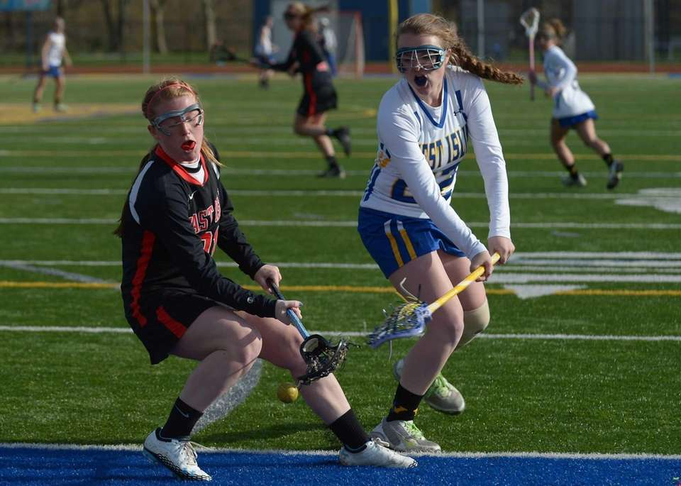 East Islip's Shannon Cummings battles West Islip's Cara