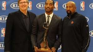 J.R. Smith, center, poses with Glen Grunwald, left,