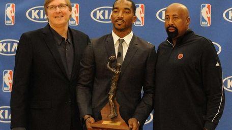 J.R. Smith, center, poses with Glen Grunwald, left,