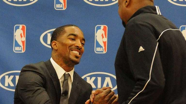 J.R. Smith gets congratulated by Mike Woodson after